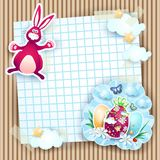 Easter card with bunny and eggs on cardboard background Stock Photo