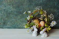 Easter card with bunny. Easter spring blossom nest and 2 easter bunny Stock Photo