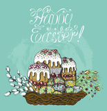 Easter card with cakes, willow and eggs. Colorful Easter card with cakes, willow and painted eggs in wicker basket on blue textured background. Line art hand Royalty Free Stock Photo