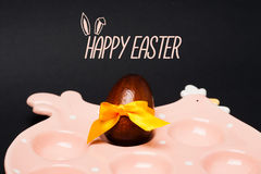 Easter card: Chicken, egg with yellow bow. Happy easter holiday concept Royalty Free Stock Photography
