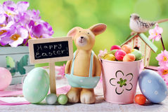 Easter card with clay rabbit and decorations on spring backgroun Stock Photography