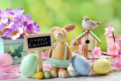 Easter card with clay rabbit and decorations on spring backgroun Stock Photos