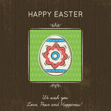 Easter card with colored egg on wooden background. Stock Image