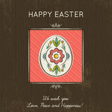Easter card with colored egg on wooden background. Stock Photo
