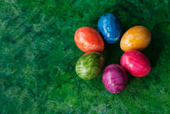 Easter card with colorful eggs. Easter decorative eggs at green background/ Place for text Stock Images