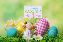 Easter card with cute lamb and eggs on the grass Stock Photography