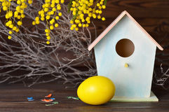 Easter card with Easter egg, birdhouse and spring flowers Royalty Free Stock Photography