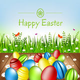 Easter card. Easter eggs, flowers and green grass. Royalty Free Stock Image
