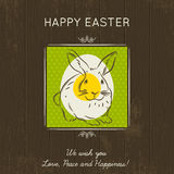 Easter card with egg and rabbit on wooden background. Royalty Free Stock Photos