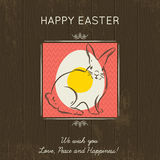 Easter card with egg and rabbit on wooden background. Royalty Free Stock Images