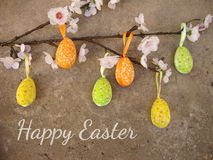 Easter card with eggs and flowers on grunge background Royalty Free Stock Photos