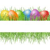 Easter card with eggs on green grass. Royalty Free Stock Photo