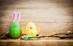 Easter card with eggs and pussy willow on rustic wooden backgrou Stock Photography