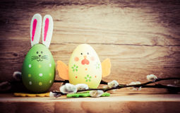 Easter card with eggs and pussy willow on rustic wooden backgrou Royalty Free Stock Image
