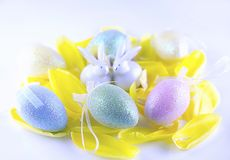 Easter card with eggs and rabbits, festive white background, decoration for the Easter holiday, macro stock images