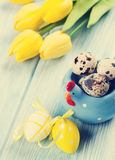 Easter card with eggs and yellow tulips Royalty Free Stock Photography