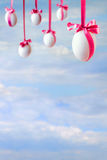 Easter card with empty space and eggs hanged on the ribbons Royalty Free Stock Images