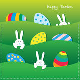 Easter card with funny bunnies and eggs. Easter paper card with a funny little bunnies and large Easter eggs in pockets Stock Photography