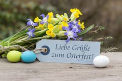 Easter card. German-language greeting card for Easter with the text Best regards for Easter Stock Image