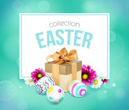 Easter card with gift box, eggs and flowers Stock Images