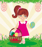 Easter card with girl and a basket of eggs Royalty Free Stock Photography