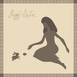 Easter card with girl and rabbit. Girl with long hair sits with  bent legs. She plays with rabbit and egg in Easter Sunday. All images look like graceful brown Royalty Free Stock Images
