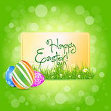 Easter Card with Grass and Decorated Eggs Stock Photo
