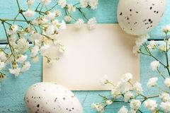 Easter card. Easter greeting card with eggs and spring flowers. frame background, copy space stock images