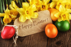 Easter Card Happy Easter with yellow flowers sunlight effect Stock Images