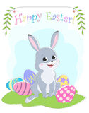 Easter card with the image of sitting on the grass rabbit, painted eggs, greeting labels and branches with leaves. Royalty Free Stock Images