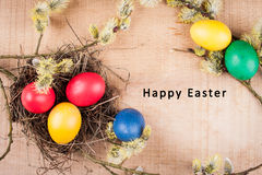 Easter card. With an inscription on a wooden background Royalty Free Stock Photos