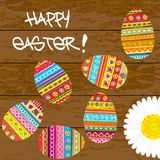 Easter card with painted Easter eggs. On wooden background Stock Photography