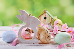 Easter card  with pastel color eggs and wooden rabbit Royalty Free Stock Photos
