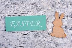 Easter card, plywood rabbit cutout. Stock Photos
