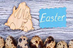 Easter card and plywood rabbits. Royalty Free Stock Photography