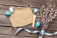 Easter card with pussy willow and eggs. Easter greeting card with pussy willow bunch and colorful eggs over wooden background Stock Image