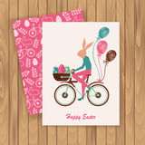 Easter card with   rabbit. Easter card with a rabbit riding a bike. vector illustration Royalty Free Stock Image
