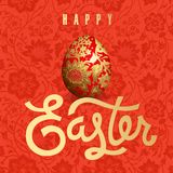 Easter card with Easter egg and inscription. Easter card with realistic Easter egg and inscription `Happy Easter`. Floral patterns. Gold foil and red color Royalty Free Stock Photo