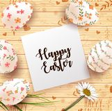 Easter Card with realistic eggs and daisy flower on wood texture background. Illustration of Easter Card with realistic eggs and daisy flower on wood texture Royalty Free Stock Photography
