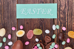 Easter card and scattered candies. Royalty Free Stock Images