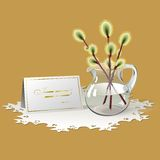 Easter card with sprigs of willow. Sprigs of willow in glass pitcher and congratulation card where you can write  your  text. All are on white openwork napkin Royalty Free Stock Photos
