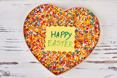 Easter card and sprinkle dots. Sweets in heart shaped box. Easter gift design royalty free stock photo