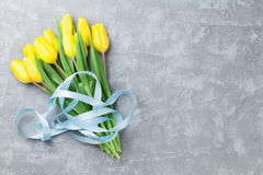 Easter card stone background with yellow tulips Stock Photos