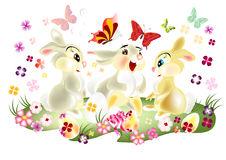 Easter card with three pretty  cartoon hare sit. Fluffy cartoon hare, Easter card with three pretty  cartoon hare sit on spring lawn Stock Photo