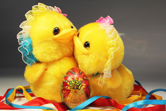 Easter card. Two chicken on the background of Easter eggs, composition decorated with ribbons under color Stock Photo