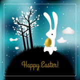 Easter card. White bunny with golden egg. Night time sky, seasonal holiday greeting postcard stock illustration
