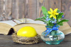 Easter card with yellow Easter egg and spring flowers Royalty Free Stock Image