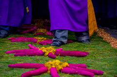 Easter carpets in antigua guatemala. Religious procession over handmade easter carpets made from colored sawdust fruits and flowers in antigua guatemala stock photo