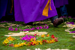 Easter carpets in antigua guatemala. Religious procession over handmade easter carpets made from colored sawdust fruits and flowers in antigua guatemala royalty free stock image