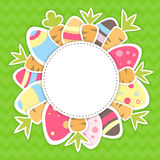 Easter carrots and eggs pattern on a green Royalty Free Stock Images